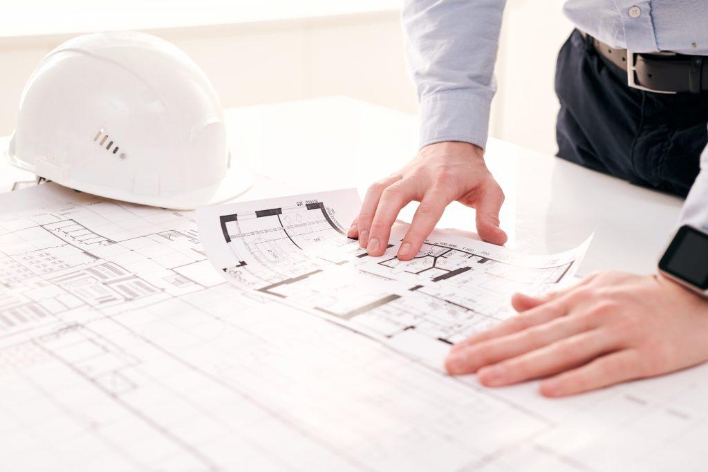 engineer-examining-blueprint